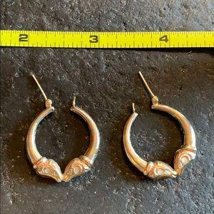 WJ 14kt gold hollow hoop pierced earrings.